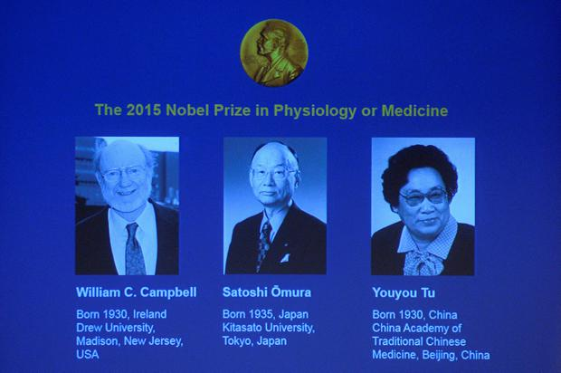 The portraits of the winners of the Nobel Medicine Prize 2015 (L-R) Irish-born William Campbell, Satoshi Omura of Japan and China's Youyou Tu are displayed on a screen during a press conference of the Nobel Committee to announce the winners of the 2015 Nobel Medicine Prize