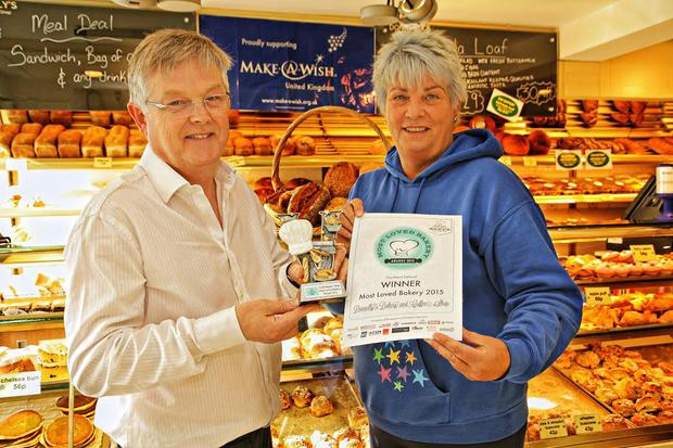 Eugene Donnelly, owner of Donnelly's Bakery and Coffee Shop, accepts award for Most Loved Bakery in Northern Ireland. (Clancy Photography)