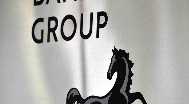 Shares in taxpayer-backed Lloyds Banking Group will be made available to retail investors in the spring, Chancellor George Osborne has announced