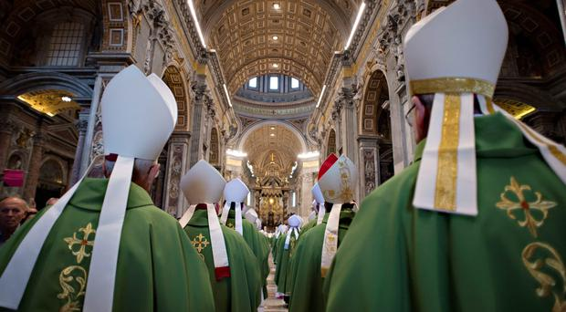 Pope Francis arrives to lead a mass for the opening of the synod on the family on October 4, 2015 at St Peter's basilica in Vatican