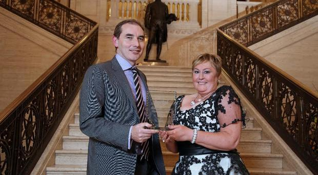 Geraldine Cassidy from Belfast, has been crowned the 2015 SuperValu SuperMum during a ceremony at Parliament Buildings, Stormont. Geraldine is pictured with Musgrave NI's Managing Director, Michael McCormack