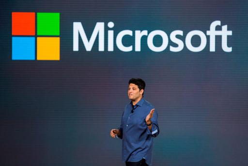 Terry Myerson, executive vice president of operating systems at Microsoft, speaks at a media event for new Microsoft products on October 6, 2015 in New York City. (Photo by Andrew Burton/Getty Images)
