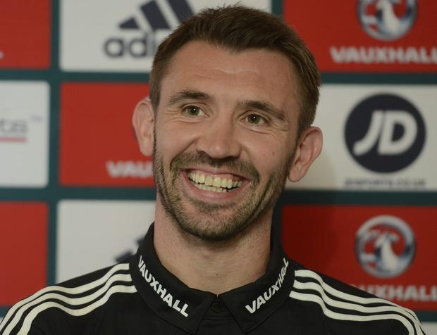 All smiles: Gareth McAuley is in positive mood ahead of tomorrow's big game with Greece