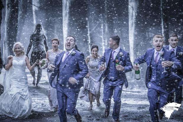 Newlyweds and huge Game of Thrones fans Mairead and Jonny Hill along with their bridal party being 'chased' by the White Walkers at Tollymore Forest. Picture: Andrew McKenna