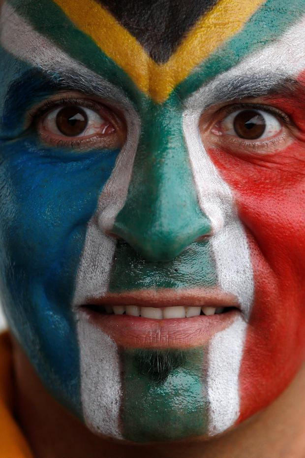 A South Africa fan with a painted face poses outside the stadium ahead of the Pool B match of the 2015 Rugby World Cup between South Africa and USA at the Olympic Stadium, east London, on October 7, 2015. AFP PHOTO / ADRIAN DENNIS