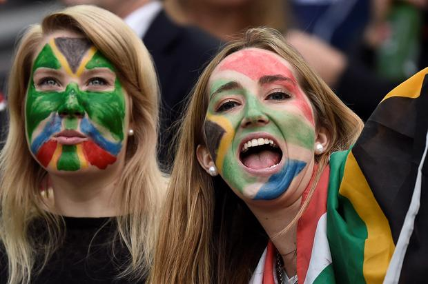 South Africa supporters cheer prior to a Pool B match of the 2015 Rugby World Cup between South Africa and USA at the Olympic Stadium, east London, on October 7, 2015. AFP/Getty Images