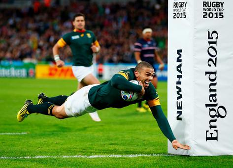 Bryan Habana of South Africa goes over to score his second try and South Africa's sixth during the 2015 Rugby World Cup Pool B match between South Africa and USA at the Olympic Stadium on October 7, 2015 in London, United Kingdom. (Photo by Shaun Botterill/Getty Images)