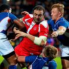 Georgia's Mamuka Gorgodze (centre) breaks through the Namibia tackles to score their first try during the World Cup match at Sandy Park, Exeter. PA