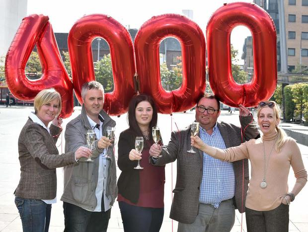 Celebrating in style are Northern Ireland Lottery winners (l to r) Sharin McCourt, Martin McKenna, Claire Marks, Peter Lavery and Anne Canavan. (Harrison Photography)