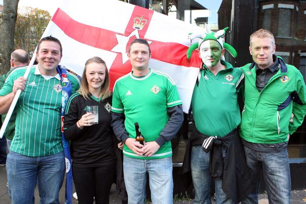Excited Northern Ireland fans before this evenings crucial game against Greece at Windsor Park. Warren Beatty, Laura Jane Kernaghan, Lee Finley, Gareth Mcquillan and Johnny McKinstry. (Picture Matt Bohill)