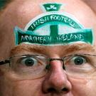 A Northern Ireland fan in the stands prior to the UEFA European Championship Qualifying match at Windsor Park, Belfast.