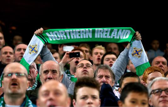 Northern Ireland fans in the stands prior to the UEFA European Championship Qualifying match at Windsor Park, Belfast. PRESS ASSOCIATION Photo. Picture date: Thursday October 8, 2015. See PA story SOCCER N Ireland. Photo credit should read: Niall Carson/PA Wire.