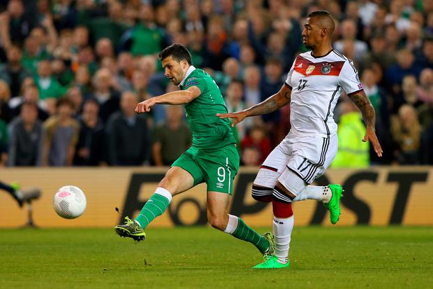 Shane Long of Republic of Ireland scores the opening goal under pressure from Jerome Boateng of Germany uring the UEFA EURO 2016 Qualifier group D match between Republic of Ireland and Germany at the Aviva Stadium on October 8, 2015 in Dublin, Ireland. (Photo by Alexander Hassenstein/Bongarts/Getty Images)