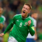Steve Davis celebrates scoring in Northern Ireland's game against Greece.