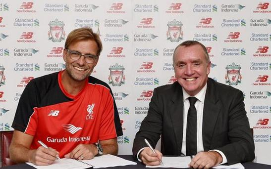 Kop idol: Jurgen Klopp (left) has penned a three-year deal to be the new Liverpool manager