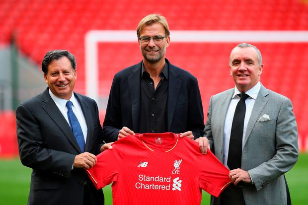 Jurgen Klopp at Anfield is unveiled as the new manager of Liverpool FC as he stands alongside Tom Werner (l) the chairman and Ian Ayre (r) the chief executive during a photocall at Anfield on October 9, 2015 in Liverpool, England. (Photo by Alex Livesey/Getty Images)