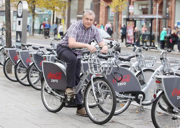 Colin Thompson has made the landmark 100,000th journey on a Belfast Bike. (Jonathan Porter/PressEye)