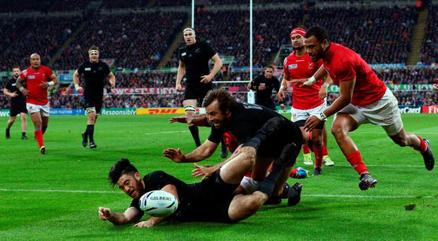 NEWCASTLE UPON TYNE, ENGLAND - OCTOBER 09: Nehe Milner-Skudder (L) of the New Zealand All Blacks scores their fourth try during the 2015 Rugby World Cup Pool C match between New Zealand and Tonga at St James' Park on October 9, 2015 in Newcastle upon Tyne, United Kingdom. (Photo by Mark Runnacles/Getty Images)