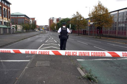 A police officer on duty in empty streets yesterday after students and staff were evacuated from Belfast Metropolitan College