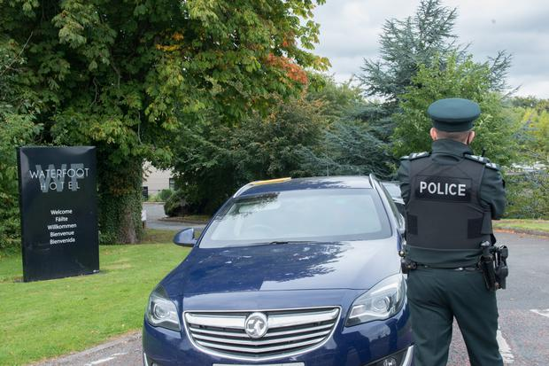 Police at the Waterfoot Hotel in Derry during the security alert