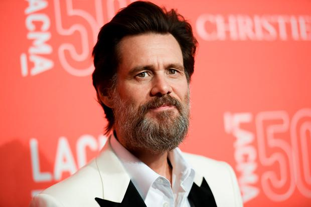 Jim Carrey says he was shocked and saddened to learn of the death of ex-girlfriend Cathriona White, likening the news to being hit by a lightning bolt. (File photo by Richard Shotwell/Invision/AP, File)