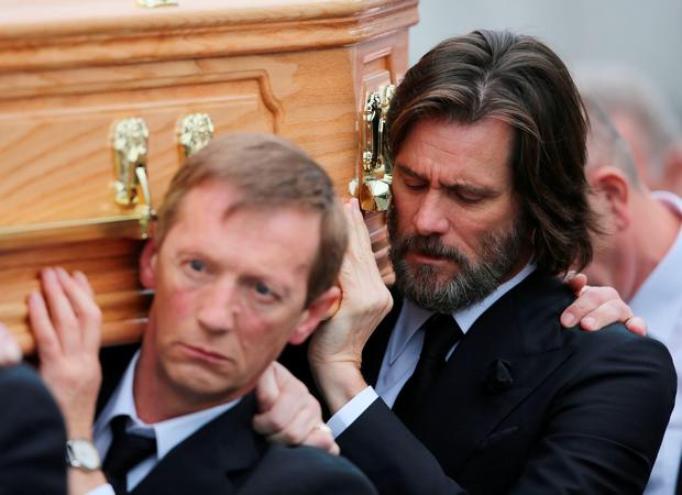 Jim Carrey carries the coffin of ex-girlfriend Cathriona White to Our Lady of Fatima Church, in her home village of Cappawhite, Co Tipperary ahead of her funeral. PA