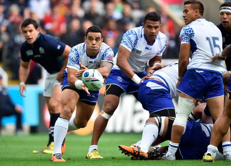 Samoa's scrum half Kahn Fotuali'i (L) passes the ball during a Pool B match of the 2015 Rugby World Cup between Scotland and Samoa at St James' Park in Newcastle-upon-Tyne, northeast England, on October 10, 2015. AFP PHOTO / BERTRAND LANGLOIS RESTRICTED TO EDITORIAL USE, NO USE IN LIVE MATCH TRACKING SERVICES, TO BE USED AS NON-SEQUENTIAL STILLSBERTRAND LANGLOIS/AFP/Getty Images