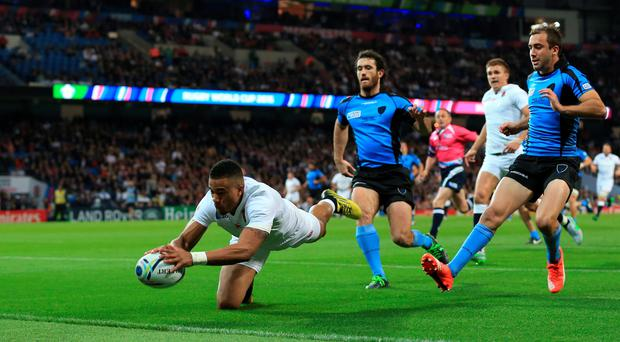 England's Anthony Watson scores the opening try of the game during the Rugby World Cup match at the City of Manchester Stadium. PRESS ASSOCIATION Photo.