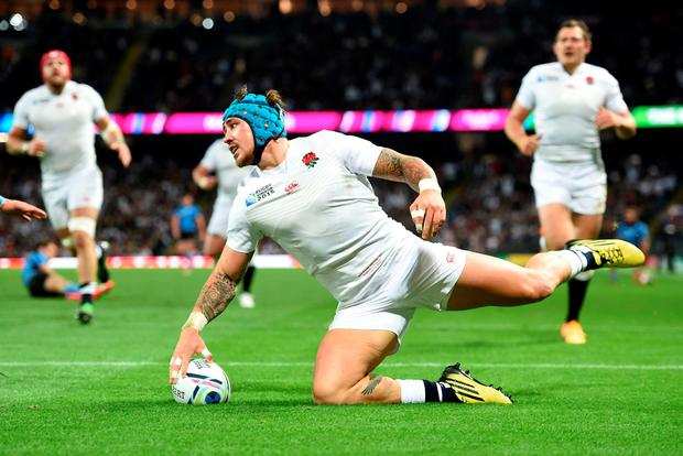 England's Jack Nowell scores his side's sixth try during the Rugby World Cup match at the City of Manchester Stadium. PRESS ASSOCIATION