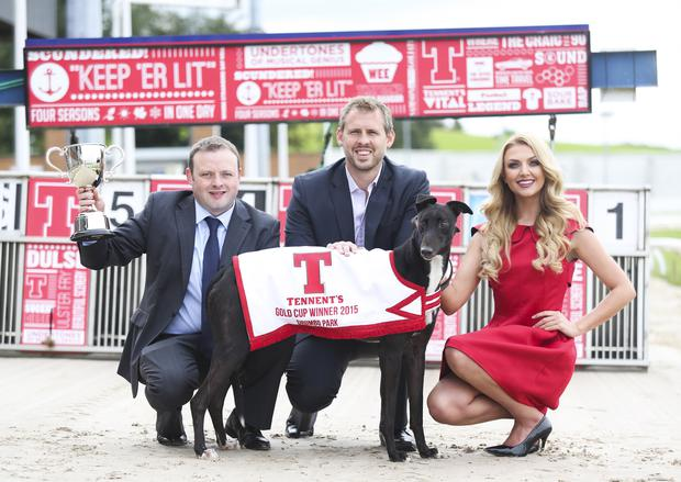 Leading lady: model Meagan Green adds a glamorous touch to the launch of the £5,000 2015 Tennent's Gold Cup which got underway at Drumbo Park Greyhound Stadium on Saturday night. Megan is pictured with (left) John Connor, Drumbo Park Racing Manager, and Brian Beattie, Marketing Director with sponsors Tennent's NI