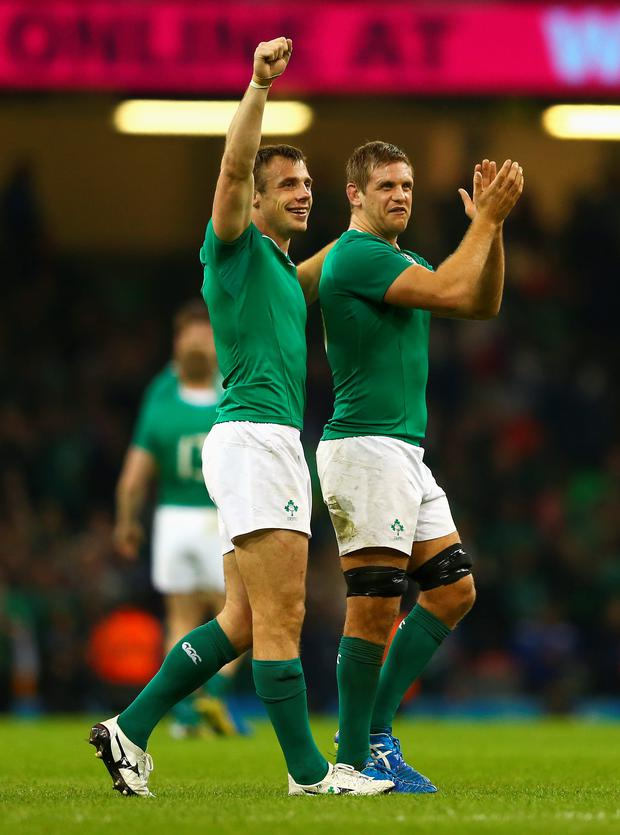 Tommy Bowe and Chris Henry celebrate the win against France