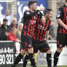 Brothers in arms: Diarmuid O'Carroll celebrates with Michael Carvill after scoring the winner at Seaview