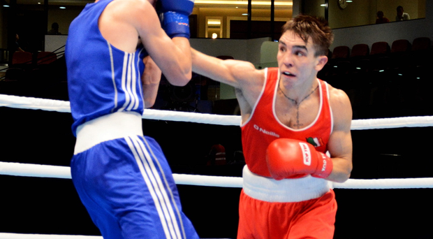 Power game: Michael Conlan lands a blow on Dzmitry Asanau