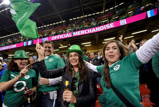 Green machine: Irish fans celebrate in the crowd at the end of the Pool D match of the 2015 Rugby World Cup between France and Ireland at the Millennium Stadium in Cardiff