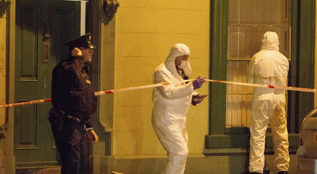Forensic officers at the scene in Newry