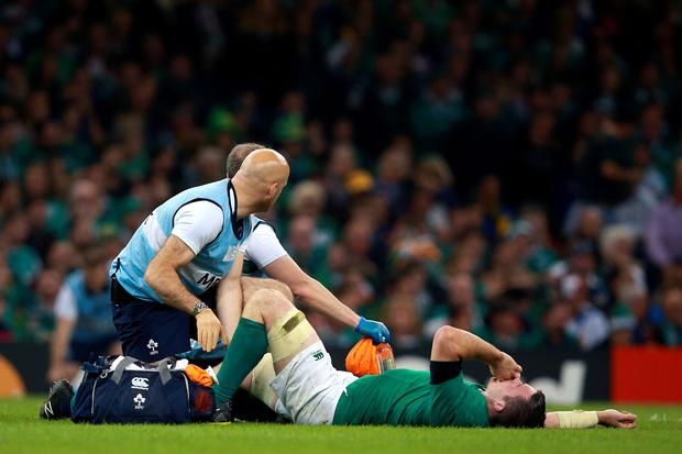 Peter O'Mahony receives treatment during the Rugby World Cup match at Millennium Stadium, Cardiff. (David Davies/PA Wire)