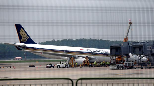 A Singapore Airlines Airbus A330-300 is seen collapsed at Changi Airport in Singapore, Sunday, Oct. 11, 2015. (Wee Teck Hian/Mediacorp via AP)