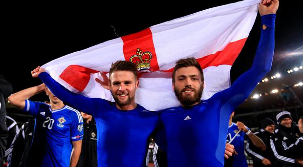 Flying the flag: Oliver Norwood and Stuart Dallas celebrate in Helsinki