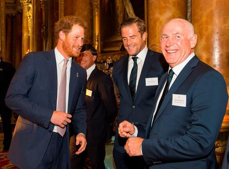 Britain's Prince Harry (L) speaks with Ireland's number 8 Jamie Heaslip (2nd R) and Ireland team manager Michael Kearney (R) at a reception to mark the Rugby World Cup 2015, at Buckingham Palace in central London on October 12, 2015. AFP/Getty Images