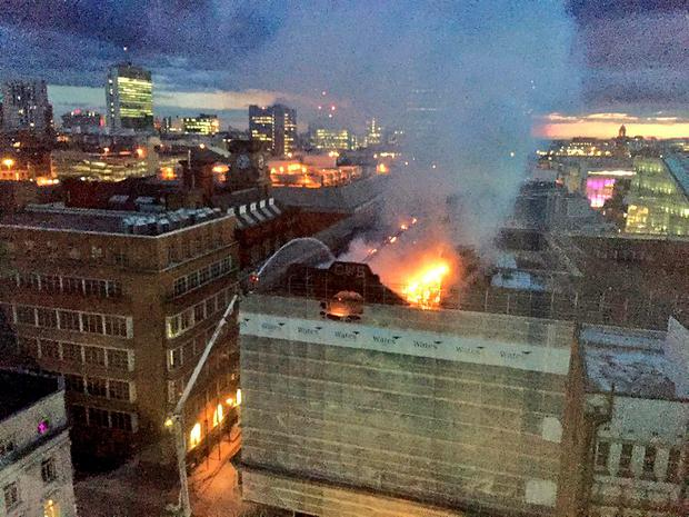 Photo taken with permission from the Twitter feed of Greater Manchester Fire and Rescue Service @manchesterfire of fire crews dealing with a serious blaze in Manchester city centre.