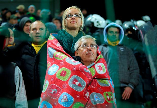 Lithuania fans keep warm during the UEFA European Championship Qualifying match at the LFF Stadium, Vilnius, Lithuania.