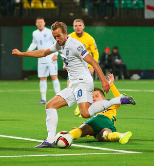 Taking aim: Harry Kane gets a shot in on goal during England's 2-0 win in Lithuania