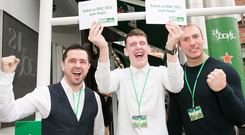Stephen Ferris (R) with winner Kristian Ross (C) who jumped for joy after winning tickets to both Rugby World Cup semi-finals at Heineken's exclusive It's Your Call event yesterday at 21 Social