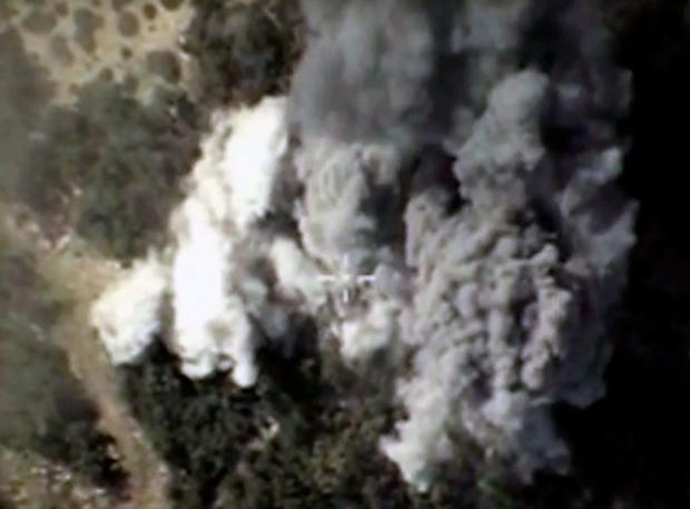 A video grab made on October 13, 2015, shows an image taken from a footage made available on the Russian Defence Ministry's official website, purporting to show explosions after airstrikes carried out by Russian air force on what Russia says was an Islamic State ammunition depot in the Syrian province of Latakia. Russia's air force hit 86