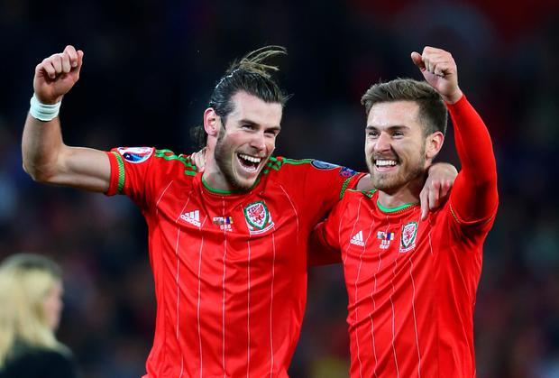 Gareth Bale and Aaron Ramsey of Wales celebrate victory after the UEFA EURO 2016 qualifying Group B match between Wales and Andorra at Cardiff City Stadium on October 13, 2015 in Cardiff, United Kingdom. (Photo by Michael Steele/Getty Images)