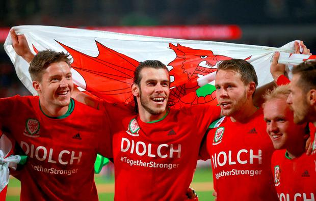 Wales' (left to right) Wayne Hennessey, Gareth Bale, Chris Gunter, Jonathan Williams and Aaron Ramsey celebrate after the UEFA Euro 2016 Qualifying match at Cardiff City Stadium, Cardiff. PA