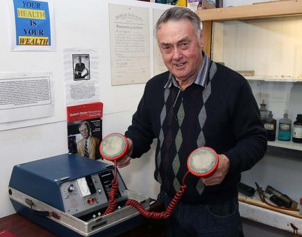 Norman Kerr with the portable defibrillator which could be the oldest surviving model