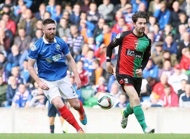 High hopes: Mark Stafford (left) will line up for Linfield against former club Ballinamallard United in tonight's JBE League Cup tie