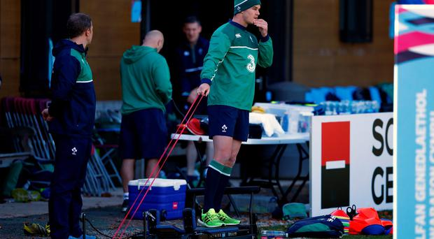 Pulling through: Jonathan Sexton takes part in light training yesterday as he bids to recover from a groin injury