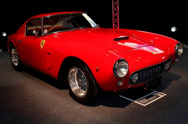 A 1960 Ferrari 250 GT short-wheelbase (SWB) Berlinetta chassis 1995 GT sold for £6,600,000. PA